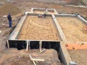 Засыпка песка фундаментом